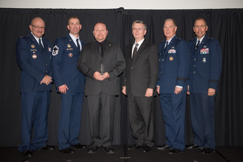 Shane Braziel, National Guard Bureau/Air National Guard Security Forces Division, Joint Base Andrews, Maryland, receives the Air National Guard Higher Headquarters Staff Civilian of 2017 Award at the 2018 Air National Guard Security Forces Squadron Dinner and Awards Banquet at the National Center for Employee Development Conference Center in Norman, Oklahoma, Sept. 12, 2018. Every year, leadership from all of the Air National Guard security forces squadrons meet in one place to discuss past, current and upcoming topics that impact the career field, as well as recognize outstanding security forces Airmen. (U.S. Air National Guard Photo by Staff Sgt. Kasey M. Phipps)