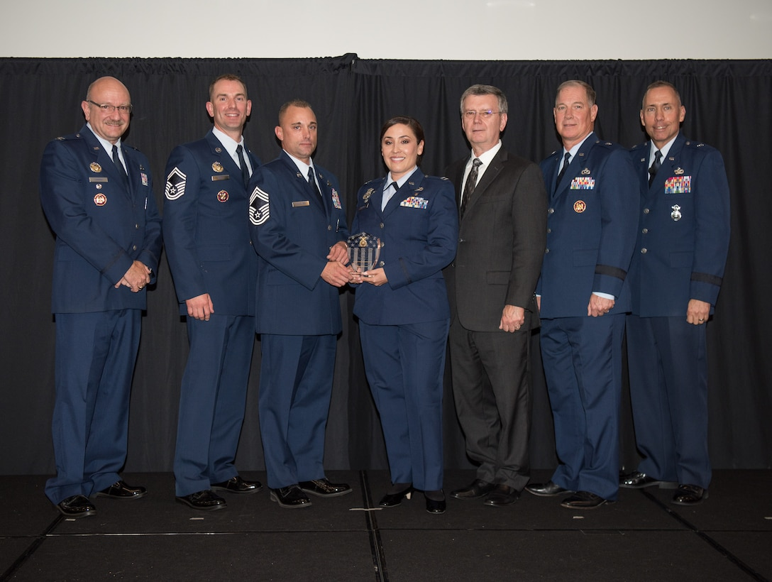 Capt. Erika Jaramillo and Chief Master Sgt. James Mulcahey, 162nd Security Forces Squadron, Tucson, Arizona, receive the Outstanding Air Reserve Component Security Forces Unit of 2017 Award at the 2018 Air National Guard Security Forces Squadron Dinner and Awards Banquet at the National Center for Employee Development Conference Center in Norman, Oklahoma, Sept. 12, 2018. Every year, leadership from all of the Air National Guard security forces squadrons meet in one place to discuss past, current and upcoming topics that impact the career field, as well as recognize outstanding security forces Airmen. (U.S. Air National Guard Photo by Staff Sgt. Kasey M. Phipps)