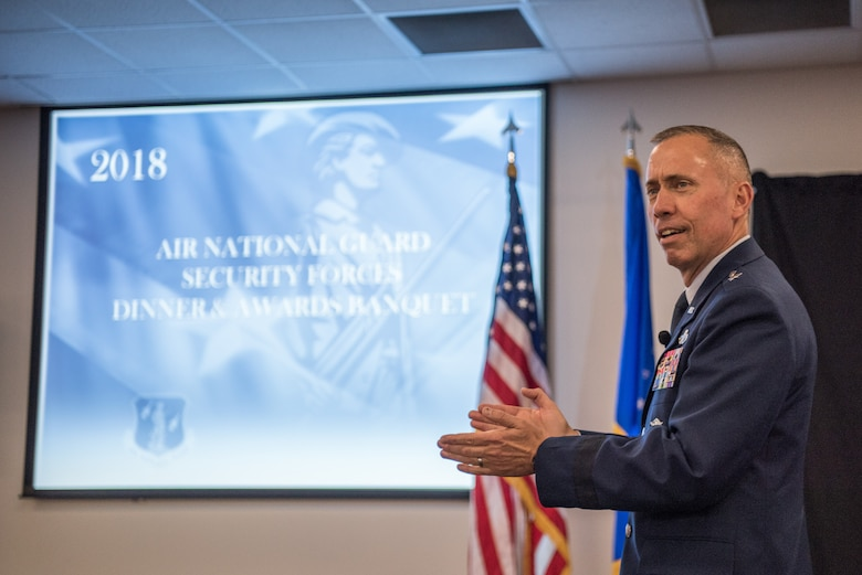 Brig. Gen. John Wilcox II, Director of Operations and Communications, Headquarters Air Force Global Strike Command, Barksdale Air Force Base, Louisiana, speaks to Air National Guard security forces Airmen during the 2018 Air National Guard Security Forces Squadron Dinner and Awards Banquet at the National Center for Employee Development Conference Center in Norman, Oklahoma, Sept. 12, 2018. Every year, leadership from all of the Air National Guard security forces squadrons meet in one place to discuss past, current and upcoming topics that impact the career field, as well as recognize outstanding security forces Airmen. (U.S. Air National Guard Photo by Staff Sgt. Kasey M. Phipps)