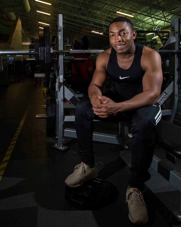 U.S. Air Force Airman 1st Class Donald Beaufort, 633rd Force Support Squadron fitness journeyman, sits on a weight bench at Shellbank Fitness Center on Joint Base Langley-Eustis, Virginia, Oct. 1, 2018.