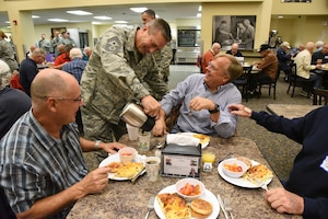 Chief Master Sgt. Duane Kangas, 119th Wing command chief, serves coffee to retired unit members at the North Dakota Air National Guard Base, Fargo, N.D., Oct. 3, 2018.
