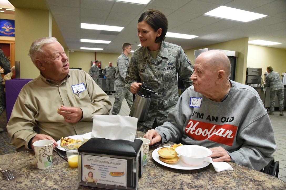 Senior Master Sgt. Merri Jo 'MJ' Filloon, of the 119th Wing, serves coffee to retired Maj. Gen. Keith Bjerke, left, and retired Chief Master Sgt. Chris Barke at the North Dakota Air National Guard Base, Fargo, N.D., Oct. 3, 2018.