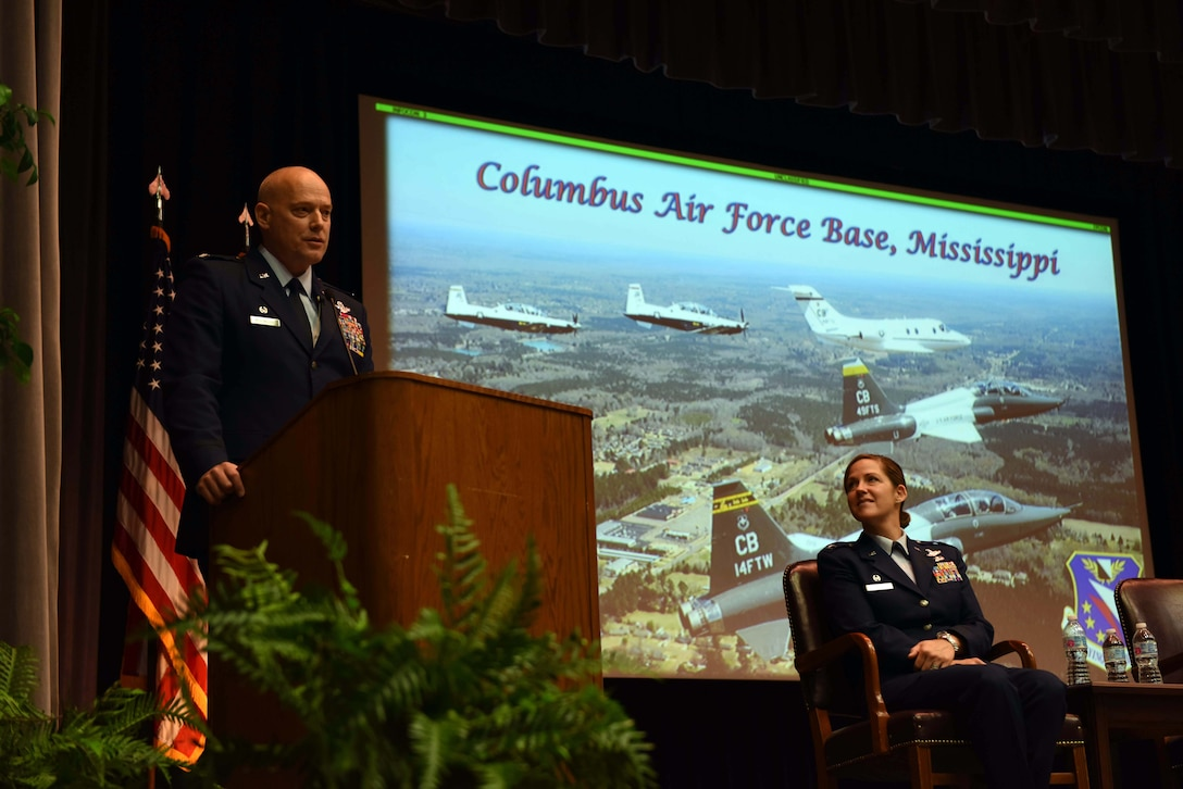 Col. Daniel McDonough, 182nd Airlift Wing commander, Peoria Air National Guard Base, Illinois, speaks during Specialized Undergraduate Pilot Training Class 18-15's graduation Sept. 28, on Columbus Air Force Base, Mississippi. McDonough told the graduates they will have to keep the discipline and self-motivation they learned in SUPT and use it to continue to keep being the best they can be. (U.S. Air Force photo by Airman 1st Class Beaux Hebert)