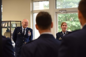 Col. Daniel McDonough, 182nd Airlift Wing commander, Peoria Air National Guard Base, Illinois, and Col. Samantha Weeks, 14th Flying Training Wing commander, speak with Specialized Undergraduate Pilot Training Class 18-15 students before their graduation Sept. 28, on Columbus Air Force Base, Mississippi. McDonough told the graduates how they are a part of the Air Force during a great time in its history. (U.S. Air Force photo by Airman 1st Class Beaux Hebert)