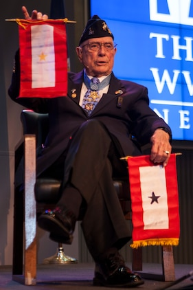 "Retired Chief Warrant Officer 4 Hershel ""Woody"" Williams, the last surviving Medal of Honor recipient from the Battle of Iwo Jima, explains the importance behind the Gold Star Flag and the Blue Star Flag to the attendees of his 95th birthday party at the National World War II Museum, Oct. 2, 2018. Williams established the ""Hershel Woody Williams Medal of Honor Foundation"" in 2010. The foundation encourages the establishment of Gold Star family Memorial Monuments. (U.S. Marine Corps photo by Lance Cpl. Tessa D. Watts)"