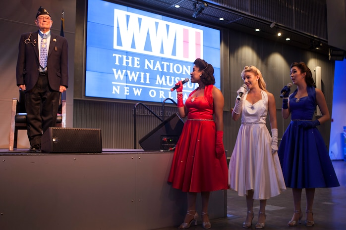 "The Victory Belles, a vocal trio, sing the Marines' Hymn during the 95th birthday party of retired Chief Warrant Officer 4 Hershel ""Woody"" Williams, the last surviving Medal of Honor recipient of the Battle of Iwo Jima, at the National World War II Museum, Oct. 2, 2018. Williams enlisted in the Marine Corps Reserve in 1943 and served in the Battle of Iwo Jima with the 21st Marines, 3rd Marine Division in 1945. (U.S. Marine Corps photo by Lance Cpl Tessa D. Watts)"