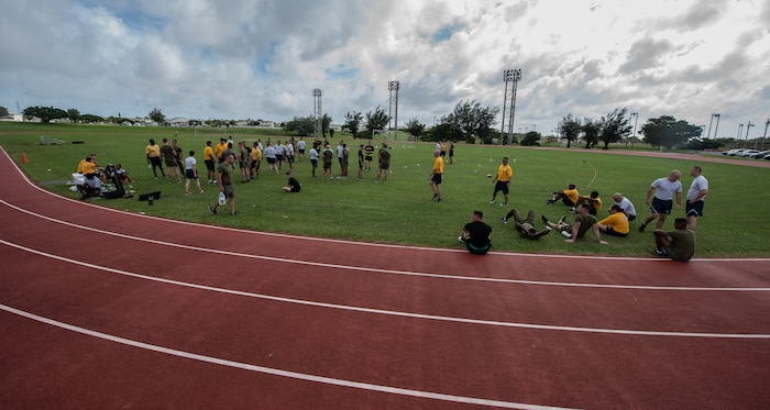 U.S. service members take a break during the Okinawa Joint Fitness Challenge Sept. 26, 2018, at Kadena Air Base, Japan. Service members from the Army, Navy, Air Force and Marine Corps were equally broken up into four classes to provide a joint learning environment. (U.S. Air Force photo by Staff Sgt. Micaiah Anthony)