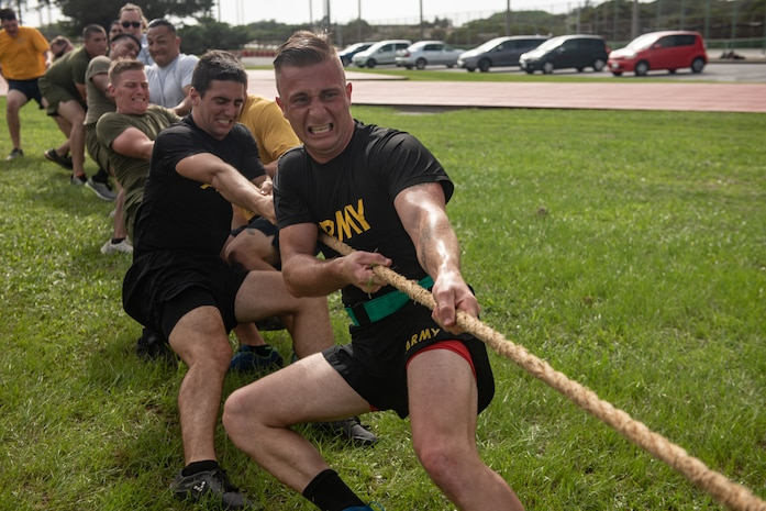 Members of the Blue Team compete in a game of tug-of-war during the Okinawa Joint Fitness Challenge Sept. 26, 2018, at Kadena Air Base, Japan. The OJFC was a portion of the OJE that enabled students to bond while overcoming obstacles and challenges faced in the battlefield. (U.S. Air Force photo by Staff Sgt. Micaiah Anthony)