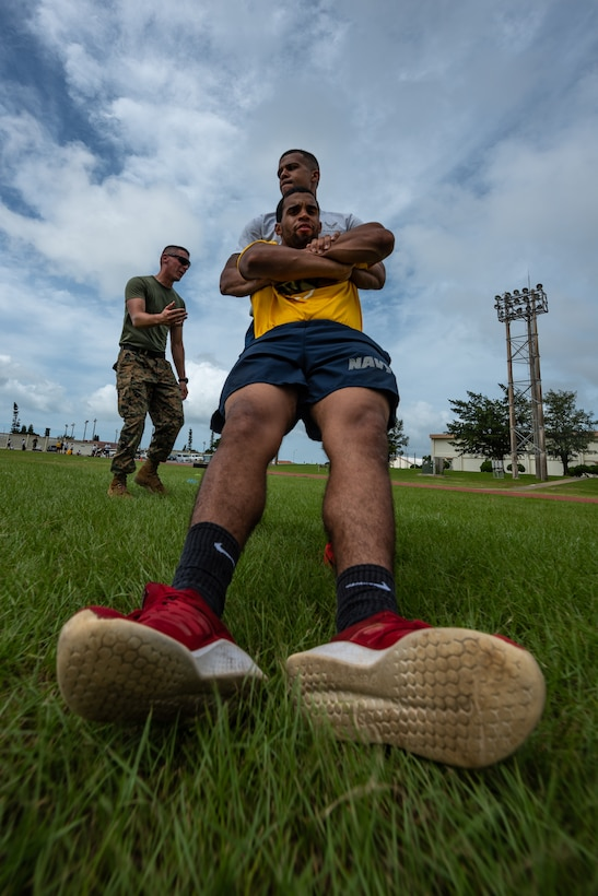U.S. Air Force Staff Sgt. Thomas Nollie carries U.S. Navy Petty Officer 2nd Class Jesse Pedrero, both Okinawa Joint Experience Green Team students, during the Okinawa Joint Fitness Challenge Sept. 26, 2018, at Kadena Air Base, Japan. Service members from the Army, Navy, Air Force and Marine Corps were equally broken up into four classes to provide a joint learning environment. (U.S. Air Force photo by Staff Sgt. Micaiah Anthony)