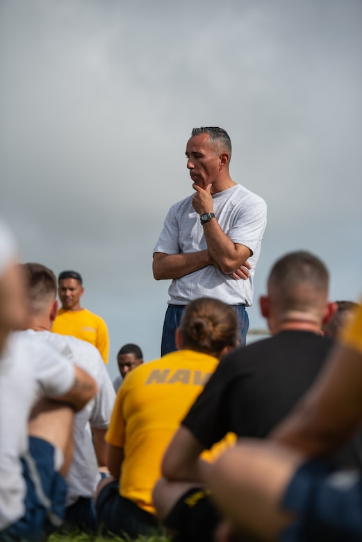 U.S. Air Force Chief Master Sgt. Heriberto Diaz Jr., Erwin Professional Military Education Center commandant, gives U.S. Soldiers, Sailors, Marines and Airmen a motivational speech after the Okinawa Joint Fitness Challenge Sept. 26, 2018, at Kadena Air Base, Japan. The OJFC was a portion of the OJE that enabled students to bond while overcoming obstacles and challenges faced in the battlefield. (U.S. Air Force photo by Staff Sgt. Micaiah Anthony)