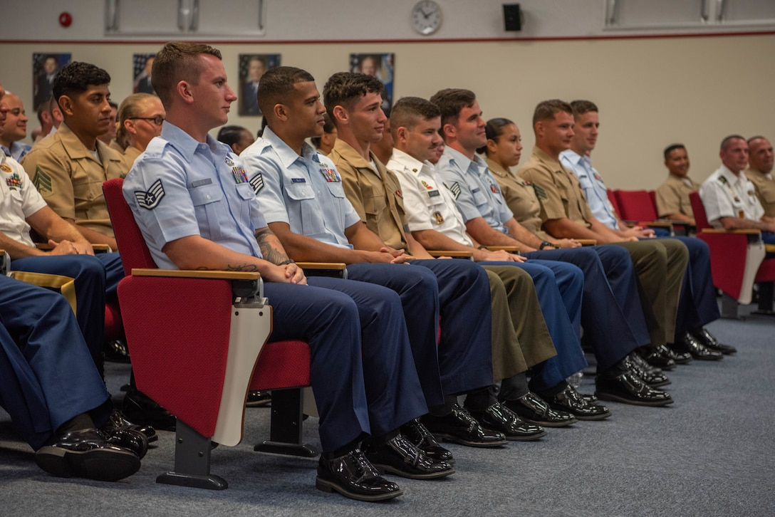 U.S. service members stationed in Okinawa participate in an Okinawa Joint Experience panel Sept. 27, 2018, at Kadena Air Base, Japan. Key leadership from each branch of service attended the panel and answered questions about the three-day course as part of the OJE. (U.S. Air Force photo by Senior Airman Kristan Campbell)