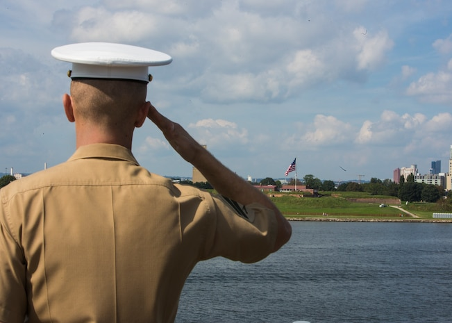 A U.S. Marine with 2nd Marine Division salutes during a Man the Rails ceremony aboard the USS Oak Hill in Balitimore, Md., Oct. 3, 2018.