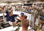 Airmen at Aviano Air Base, Italy filled the Army and Air Force Exchange Service sales store to purchase the Operational Camouflage Pattern utility uniform October 1, 2018. DLA Troop Support Clothing and Textiles worked with its Air Force counterparts and other key stakeholders since April to ensure more than 17,000 uniforms were delivered to five military clothing sales stores, including Aviano Air Base, Shaw Air Force Base, South Carolina, the Pentagon, Washington, D.C., Joint Base Charleston, South Carolina and MacDill AFB, Florida for the initial fielding.