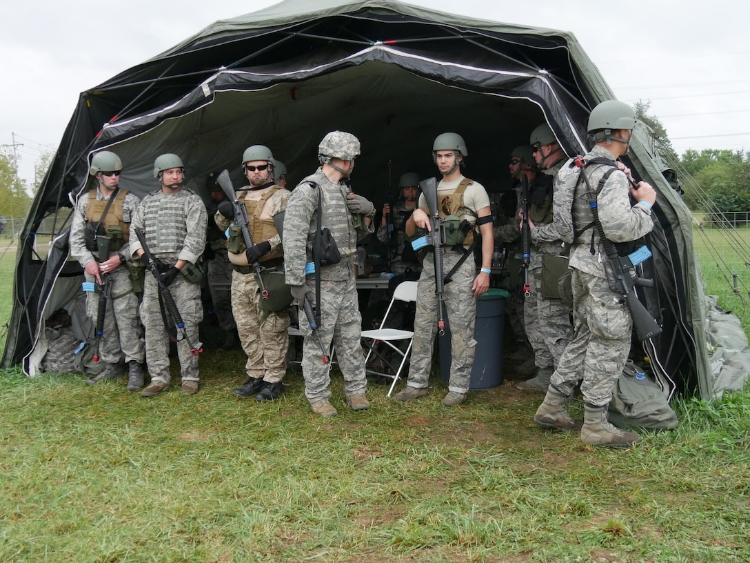Participants take a break from field training activities during Operation Tech Warrior 2018. Air Force instructors lead these exercises, which replicate military missions and tactics for the battlefield. (U.S. Air Force photo/Kenneth McNulty)