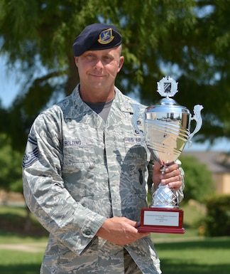 Senior Master Sgt. Chad Bolding, 507th Security Forces Squadron operations superintendent, holds the International Bavarian Military Competition first place trophy Aug. 3, 2018, at Tinker Air Force Base, Oklahoma. Bolding was the captain of the Air Force Reserve Command team who won first place at the international competition. (U.S. Air Force photo by Tech. Sgt. Samantha Mathison)