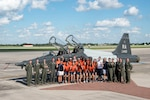Members of the University of Texas San Antonio Women's Basketball Team pose for a photo with Maj. Gen. Patrick Doherty, 19th Air Force commander, and members of the 560th Flying Training Squadron Sept. 25, 2018, at Joint Base San Antonio-Randolph, Texas. The UTSA Women's Basketball Team visited JBSA-Randolph to speak to Airmen about the importance of teamwork and commitment. (U.S. Air Force photo by Senior Airman Stormy Archer)