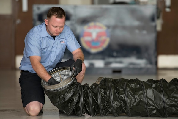 Jonathan Beres, 12th Flying Training Wing aerospace ground equipment mechanic, inspects the serviceability of a New Generation Heater duct during routine maintenance Aug. 28, 2018, at Joint Base San Antonio-Randolph, Texas. Beres is part of a team that inspects, tests and maintains ground equipment that supports aircraft maintenance and flying training operations.