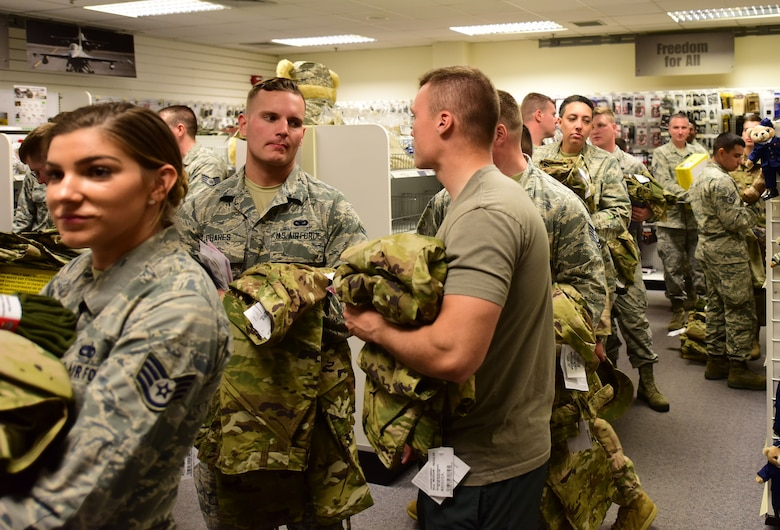 Airmen wait in line to purchase the Operational Camouflage Pattern uniform at Military Clothing Sales on Aviano Air Base Oct. 1, 2018.