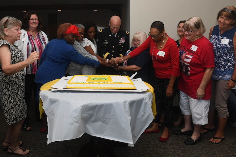 U.S. Army Maj. Gen. John George, Army Capabilities Integration Center deputy director, cuts a cake in honor of Gold Star Mother's Day at Joint Base Langley-Eustis, Virginia, Sept. 30, 2018. The Survivor Outreach Services is an Army-wide program that provides support to families of deceased service members. (U.S. Air Force photo by Senior Airman Derek Seifert)