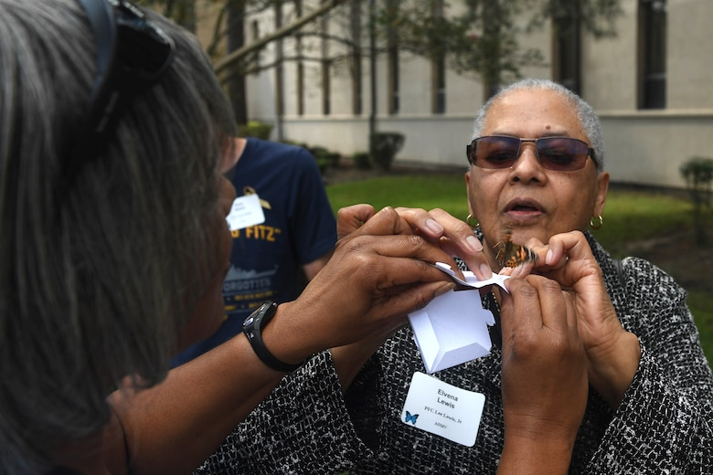 Elvena Lewis, mother of deceased U.S. Army Pfc. Lee Lewis Jr., releases a butterfly during the Gold Star Mother's Day event at Joint Base Langley-Eustis, Virginia, Sept. 30, 2018. Releasing butterflies symbolizes endurance and how Gold Star families had to embrace change and the search of hope. (U.S. Air Force photo by Senior Airman Derek Seifert)