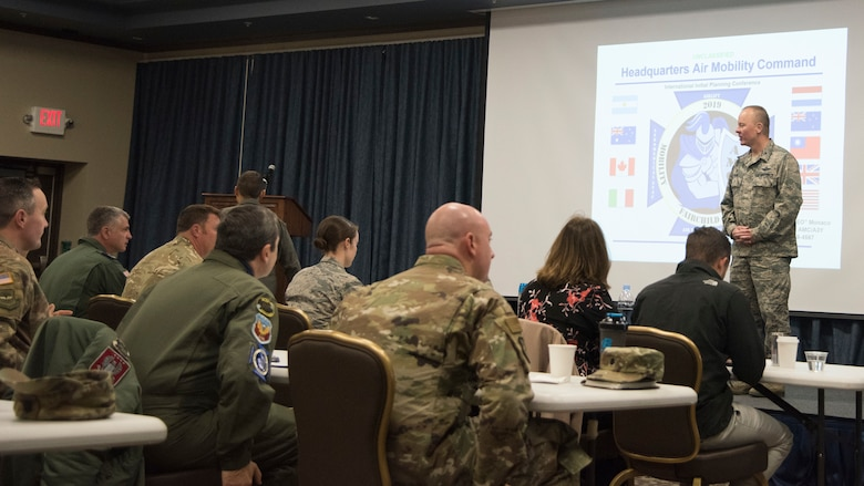 U.S. Air Force Col. Derek Salmi, 92nd Air Refueling Wing commander, greets attendees of the Mobility Guardian 2019 International Planning Conference held at Fairchild Air Force Base, Washington, Sept. 18, 2018. The conference served as a brainstorming session for contexts to increase teamwork between partnered militaries during the exercise by joining forces to accomplish critical training goals so allied forces can integrate seamlessly at a moment's notice. (U.S. Air Force photo/Senior Airman Ryan Lackey)