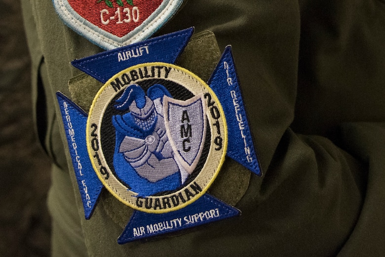 An international attendee wears the ceremonial patch of Mobility Guardian 2019 at the International Planning Conference held at Fairchild Air Force Base, Washington, Sept. 19, 2018. Partner forces don't always use the same equipment or similar operating procedures, so familiarization via training with other forces helps everyone know other military capabilities and compatibilities. (U.S. Air Force photo/Senior Airman Ryan Lackey)