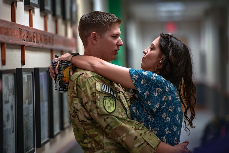 Capt. Travis Worrell, 41st Rescue Squadron HH-60G Pave Hawk helicopter pilot, embraces his wife Brittany prior to a deployment, Sept. 26, 2018, at Moody Air Force Base, Ga. The 41st RQS and the 41st Helicopter Maintenance Unit will provide combat search and rescue capabilities and maintenance operations in a forward deployed location. (U.S. Air Force photo by Senior Airman Greg Nash)