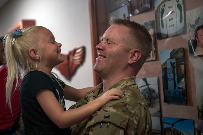 Capt. Casey Doane, 41st Rescue Squadron HH-60G Pave Hawk helicopter pilot, embraces his daughter prior to a deployment, Sept. 26, 2018, at Moody Air Force Base, Ga. The 41st RQS and the 41st Helicopter Maintenance Unit will provide combat search and rescue capabilities and maintenance operations in a forward deployed location. (U.S. Air Force photo by Senior Airman Greg Nash)