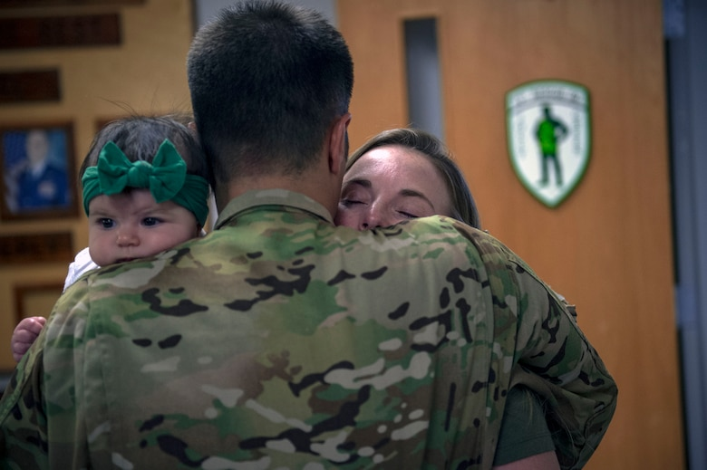 Capt. Philip Veltre, 41st Rescue Squadron HH-60G Pave Hawk helicopter pilot, hugs his wife Justine and daughter Lin, prior to a deployment, Sept. 26, 2018, at Moody Air Force Base, Ga. The 41st RQS and the 41st Helicopter Maintenance Unit will provide combat search and rescue capabilities and maintenance operations in a forward deployed location. (U.S. Air Force photo by Senior Airman Greg Nash)