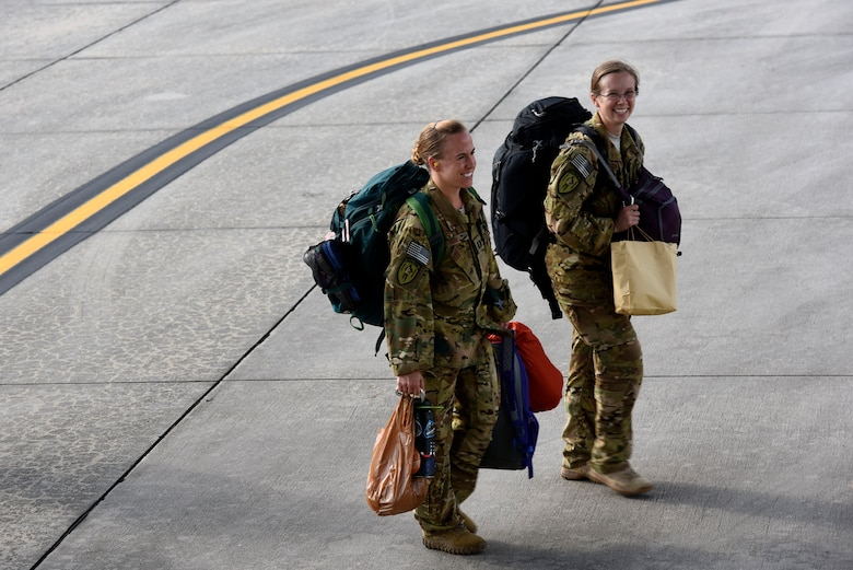 41st Rescue Squadron HH-60G Pave Hawk helicopter pilots Capt. Amanda May, left, and Capt. Chelsey Hamilton, share a laugh before boarding a C-5 Galaxy prior to a deployment, Sept. 26, 2018, at Moody Air Force Base, Ga. The 41st RQS and the 41st Helicopter Maintenance Unit will provide combat search and rescue capabilities and maintenance operations in a forward deployed location. (U.S. Air Force photo by Senior Airman Greg Nash)