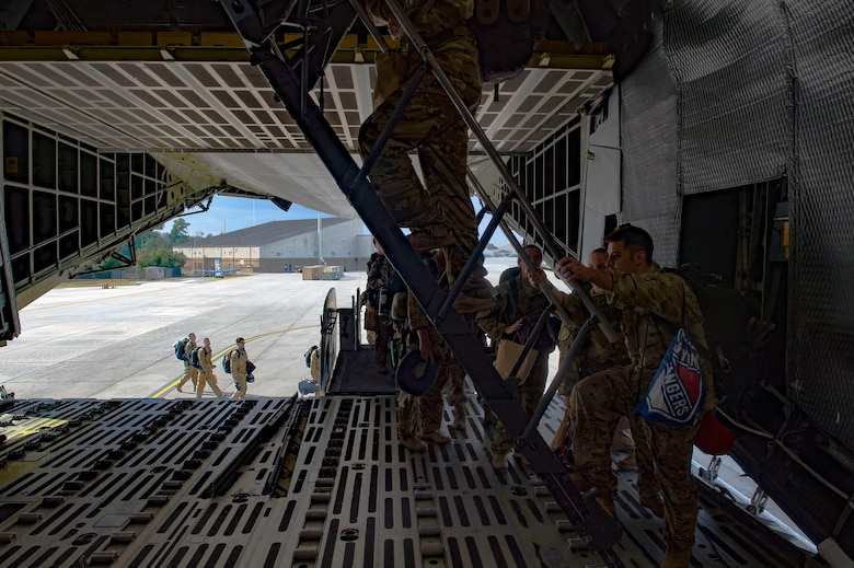 41st Rescue Squadron Airmen board a C-5 Galaxy prior to a deployment, Sept. 26, 2016, at Moody Air Force Base, Ga. The 41st RQS and the 41st Helicopter Maintenance Unit will provide combat search and rescue capabilities and maintenance operations in a forward deployed location. (U.S. Air Force photo by Senior Airman Greg Nash)