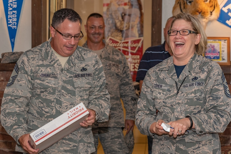 U.S. Air Force Chief Master Sgt. Shelley Cohen, 307th Bomb Wing command chief, and her husband Chief Master Sgt. Pete Cohen, enjoy a light moment during her farewell dinner at Barksdale Air Force Base, La, Sept. 7, 2018.   Cohen is moving on to a position with 8th Air Force. (U.S. Air Force Photo by Tech. Sgt. Cody Burt)
