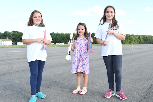 IMAGE: Centennial Rocket Competition participants with their rockets.