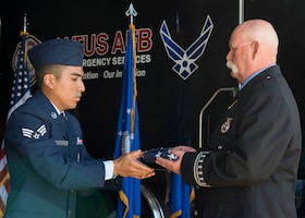 Airman passing the American flag to Billy Allday