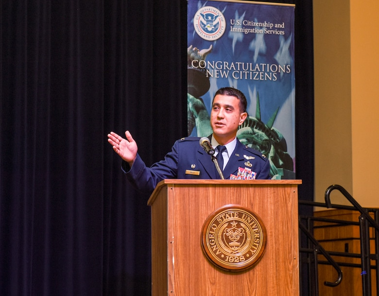 U.S. Air Force Col. Ricky Mills, 17th Training Wing commander, speaks during the naturalization ceremony held on Sept. 25, 2018 at the CJ Davidson Center on Angelo State University, San Angelo, Texas. Mills shared stories about how his mother was naturalized in 1974 in San Francisco when he was only two-years-old. (U.S. Air Force photo by Aryn Lockhart/Released).