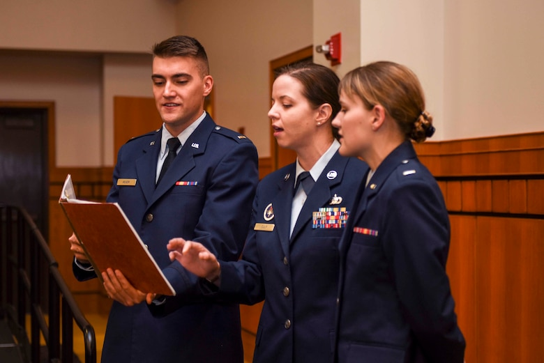 "Members of Patriotic Blue, 2nd Lt. Alexander Heger, 315th Training Squadron student, TSgt Starla Culp, 315th TRS instructor, and 1st Lt Kaitlyn Sprague, 315th TRS student, sing ""America the Beautiful"" during the naturalization ceremony held at the CJ Davidson Center on Angelo State University, San Angelo, Texas. The ceremony naturalized 76 individuals from 13 different countries.  (U.S. Air Force photo by Aryn Lockhart/Released)"