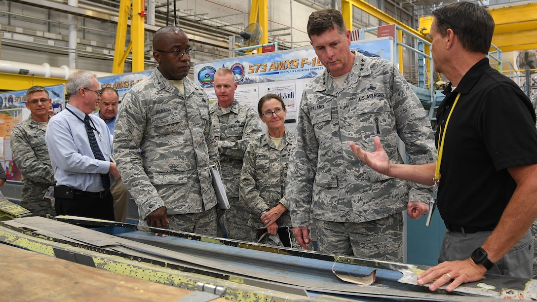Joseph Gardenhour (right), 573rd Aircraft Maintenance Squadron director, speaks with Lt. Gen. Gene Kirkland, Air Force Sustainment Center commander, and other leaders during the general's site visit Oct. 2, 2018, at Hill Air Force Base, Utah. (U.S. Air Force photo by R. Nial Bradshaw)