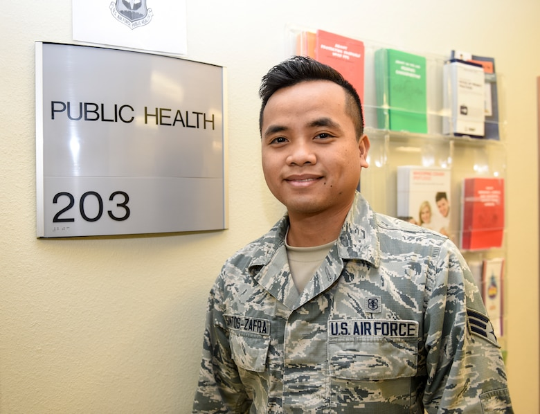 U.S. Air Force Senior Airman John Santos Zafra, 17th Medical Operations Squadron public health technician stands next to his office at the Ross Clinic on Goodfellow Air Force Base, Texas, Sept. 24, 2018. Zafra has been living in the states since he was 13- years-old and used the assistance of the Air Force to become a U.S. citizen.  (U.S. Air Force photo by Aryn Lockhart/Released)