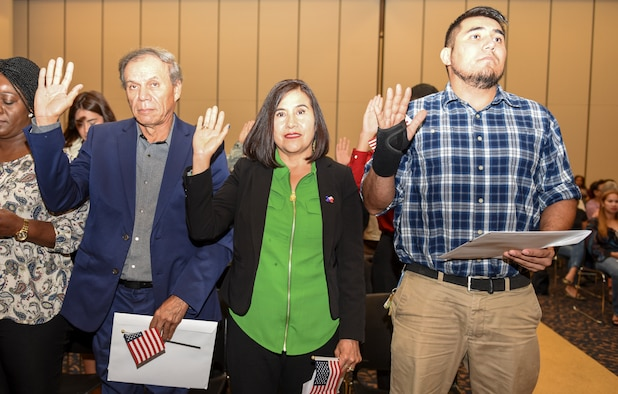 Angelo Inn housekeeper, Rosa Drake, takes her citizenship oath during the naturalization ceremony held at the CJ Davidson Center on Angelo State University, San Angelo, Texas, Sept. 25, 2018. Drake took classes through a partnership agreement with Howard University and Goodfellow Air Force Base that helped her to achieve U.S. citizenship. (U.S. Air Force photo by Aryn Lockhart/Released)