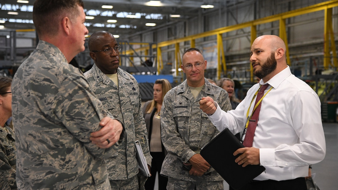Gene Kourtei (right), 572nd Aircraft Maintenance Squadron director, speaks with Lt. Gen. Gene Kirkland, Air Force Sustainment Center commander, and other leaders during the general's site visit Oct. 2, 2018, at Hill Air Force Base, Utah. (U.S. Air Force photo by R. Nial Bradshaw)