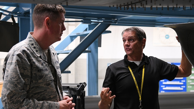 Joseph Gardenhour(right), 573rd Aircraft Maintenance Squadron director, speaks with Lt. Gen. Gene Kirkland, Air Force Sustainment Center commander, during thje general's site visit Oct. 2, 2018, at Hill Air Force Base, Utah. (U.S. Air Force photo by R. Nial Bradshaw)