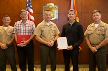 Marine Corps Recruit Depot, San Diego, California – Mr. David A. Drzewiecki and Mr. Richard E. Myrick stand proudly with the Marine Corps Recruit Depot and Western Recruiting Region Chief of Staff, and their respective assistant chiefs of staff after receiving length of service awards aboard the depot October 4, 2018.
