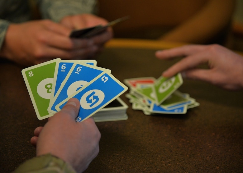 Airmen demonstrate a card game Aug. 27, 2018, at the Grizzly Bend at Malmstrom Air Force Base, Mont.