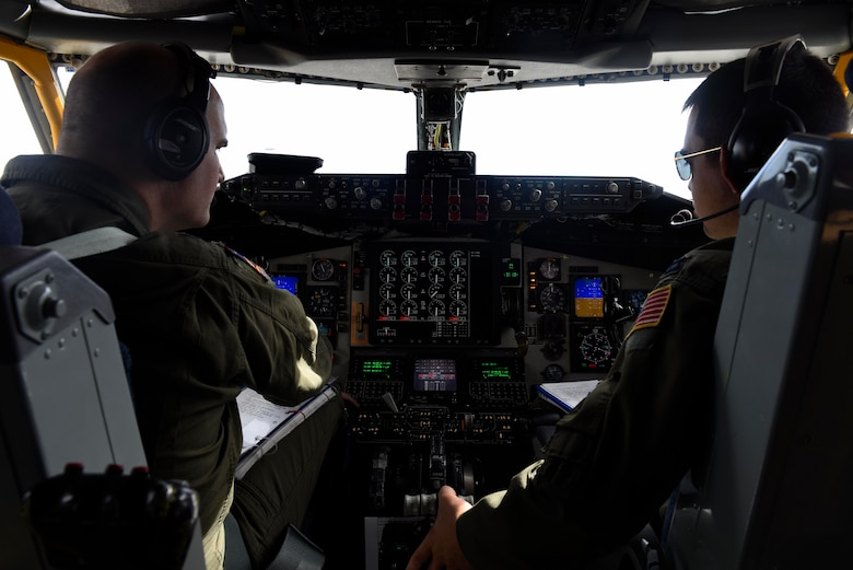 Lt. Col. Travis Christiensen (left) and Capt. Joey Springfield (right), 384th Air Refueling Squadron KC-135 Stratotanker pilots, perform pre-flight inspections at Farichild Air Force Base, Washington, Oct. 3, 2018. Airmen from Farichild's 384th ARS supported the KC-46A Pegasus during a training operation with the B-52 Stratofortress. (U.S. Air Force photo/Airman 1st Class Lawrence Sena)