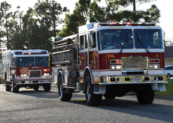 Fire trucks drive by Oct. 13, 2017, on Vandenberg Air Force Base, Calif. The drive was part of Fire Prevention Week.