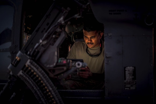 An Airman works on a helicopter
