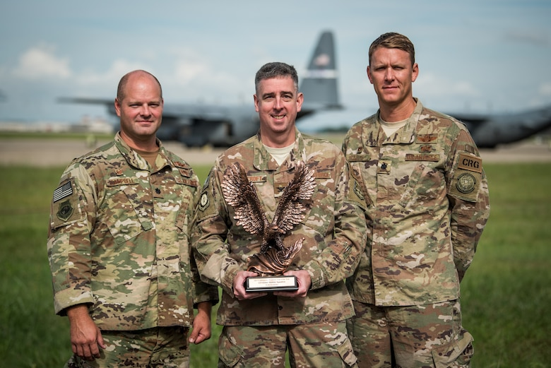 The Kentucky Air National Guard's 123rd Global Mobility Squadron has been named the Air Mobility Command Contingency Response Unit of the Year for 2017. Shown with the award are Lt. Col. Steve Campbell (left), 123rd GMS commander, Col. Bruce Bancroft (center), commander of the 123rd Contingency Response Group, and Lt. Col. Ryan Adams (right), commander of the 123rd Global Mobility Readiness Squadron. The 123rd GMS was chosen for the honor over multiple active-duty and Reserve contingency response units. (U.S. Air National Guard photo by Staff Sgt. Joshua Horton)