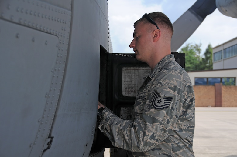 Tech. Sgt Joel Putnam, a 94th Aircraft Maintenance Squadron crew chief, prepares a C-130H3 Hercules for fueling at Ramstein Air Base, Germany June 14, 2018. Joel and his brother Jeremy are both assigned to the 94th Maintenance Group at Dobbins Air Reserve Base, Ga. (U.S. Air Force photo/Senior Airman Justin Clayvon)