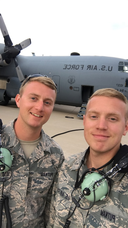 Tech. Sgt. Joel Putnam, a 94th Aircraft Maintenance Squadron crew chief, left, and his brother, Staff Sgt. Jeremy Putnam, a 94th Maintenance Squadron aerospace propulsion technician, pose for a photo in front of a C-130H3 Hercules at Dobbins Air Reserve Base, Ga. Joel and his brother Jeremy are both assigned to the 94th Maintenance Group at Dobbins Air Reserve Base, Ga. (U.S. Air Force photo/Senior Airman Justin Clayvon)