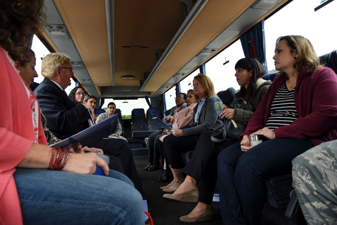 Spouses of 86th Airlift Wing command leadership tour the Ramstein Teen Center during the 86 AW Commander's Mission Support Group Immersion on Ramstein Air Base, Germany, Oct. 2, 2018. During the tour of the teen center, spouses were able to utilize a few of the amenities available to the teens such as a virtual reality console and a flight simulator. (U.S. Air Force photo by Airman D. Blake Browning)